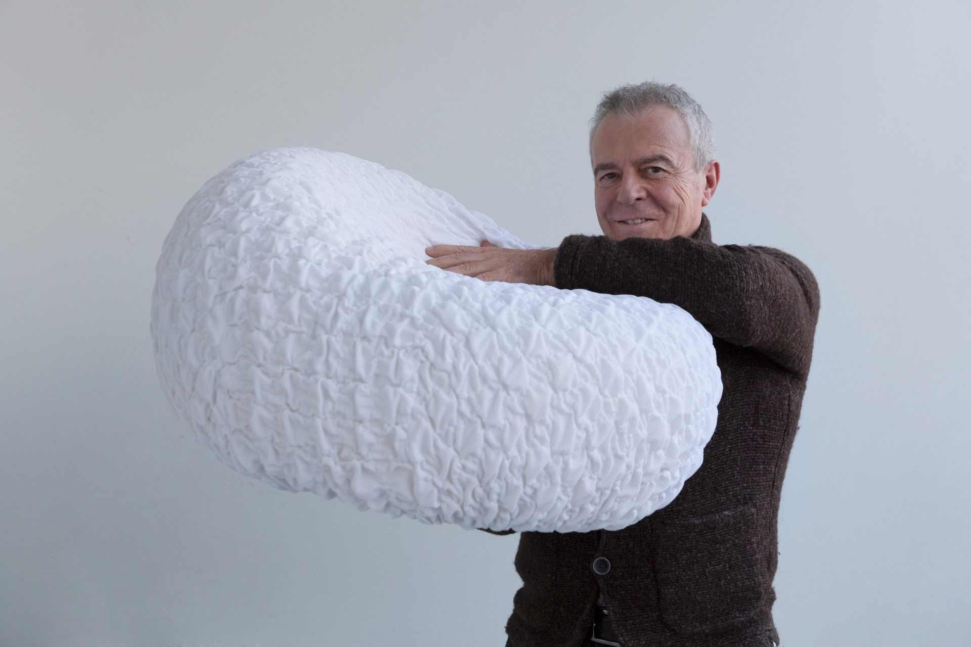 Studio Sanaa chair shaped L16 cloud with Luciano Marson Creative Director of LightsOn