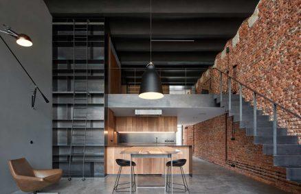 Antigua cervecería convertida en un loft de estilo industrial por CMC Architects